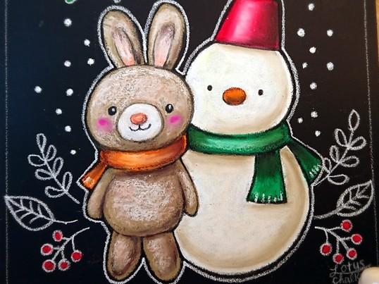 チョークアートで「雪だるまとうさぎ」のボードを制作の画像