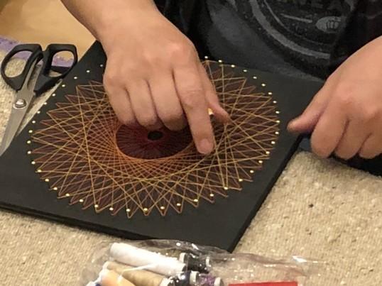 「糸かけ曼荼羅」の画像